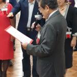 Tetuya lê Termo de Compromisso de Juramento (Jiro Mochizuki e Aldo Shiguti)